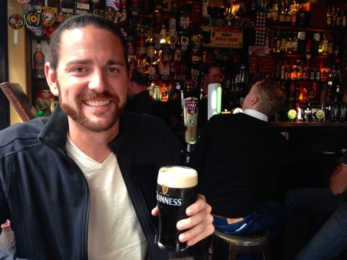 Matt drinking a Guinness at the Temple Bar in Dublin
