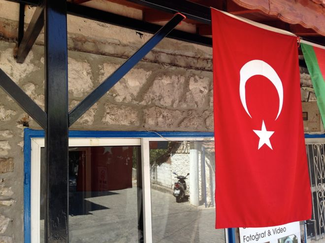 A turkish flag hangs in Uzumlu, Turkey