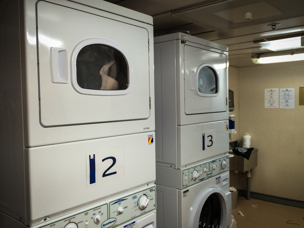 Laundry room on the Adonia with Fathom Travel